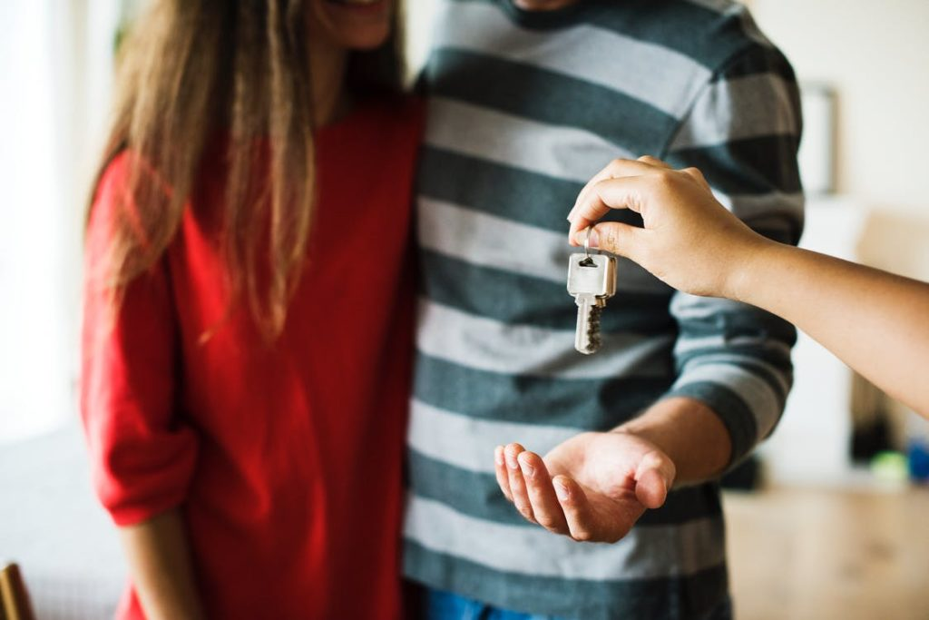 Man and woman handed keys to property